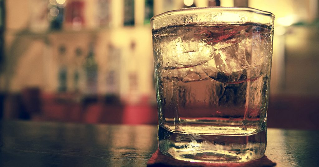 A glass of whiskey on the bar macro image